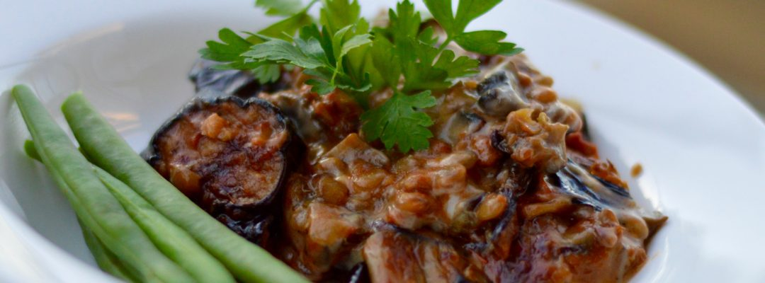 Aubergine and lentil vegetarian casserole with creamy mushroom layer